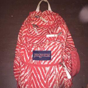 Orange salmon color big backpack.